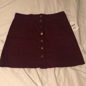 Maroon colored women's skirt